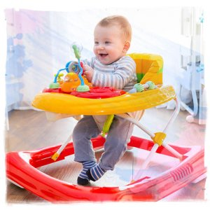 baby using colorful walker chair